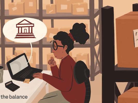 This illustration shows a small business owner researching the best banks for small businesses on a computer in the stock room of a business.