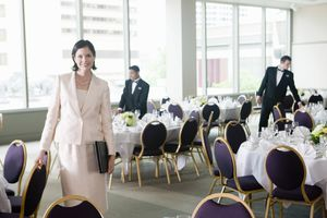 Businesswoman with clipboard in luncheon room