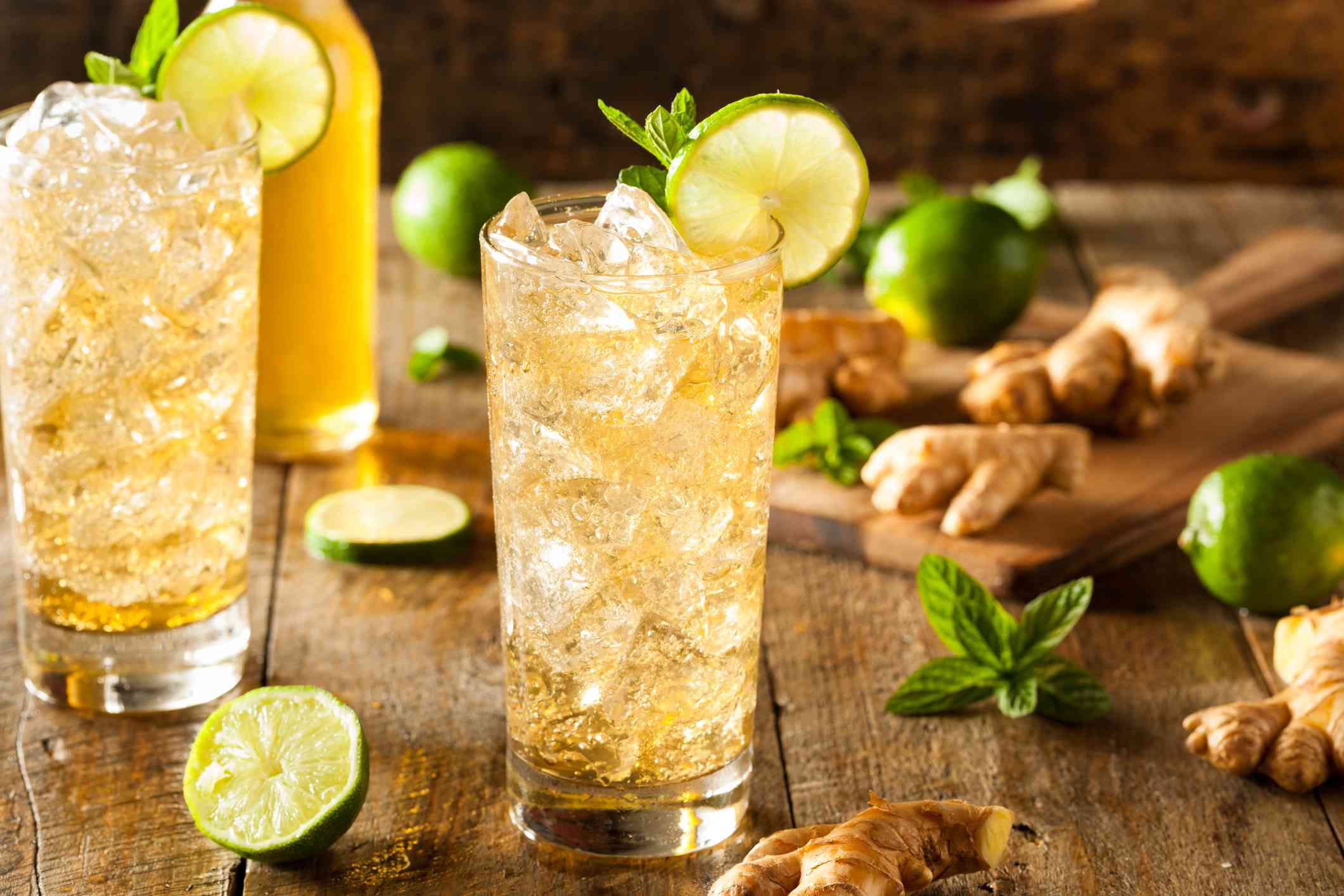 glasses of ginger ale with lime and ginger