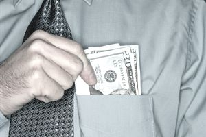 Businessman holding twenty dollar notes in shirt pocket, close-up