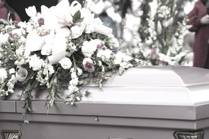 Funeral casket decorated with flowers