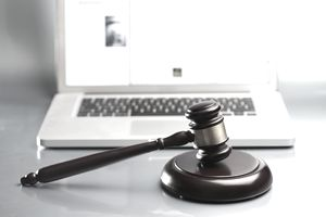 Gavel in front of a laptop representing eBay's seller protections.