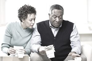 Couple adding up business receipts
