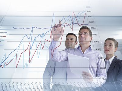 Business people examining graphs