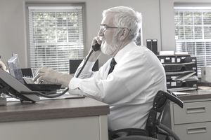 Gray-haired disabled business person