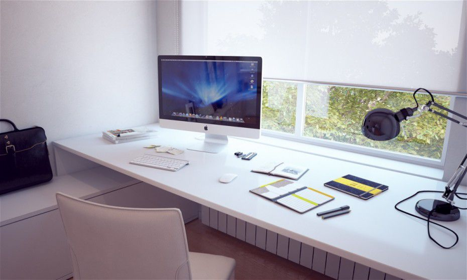 White minimalist desk situated up against a window
