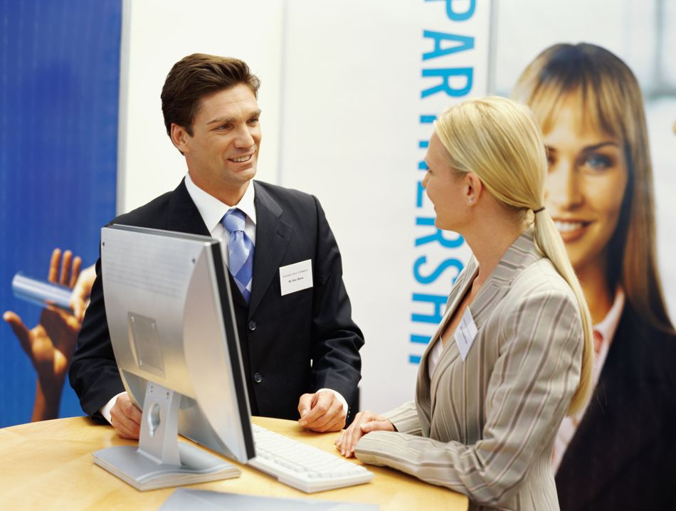 Attendees at a trade show booth