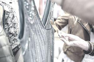Woman looking at price tag on clothing