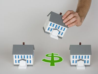 Row of miniature houses and dollar sign