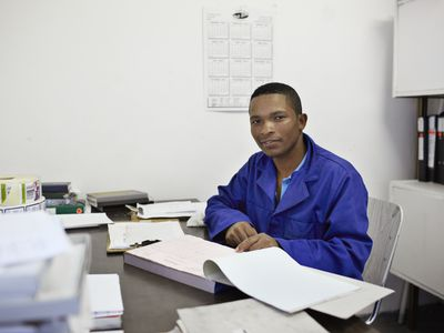 man sitting at desk with book