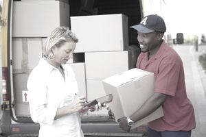 Delivery person delivering a truckload of product to an export buyer.