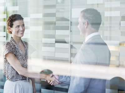 Woman shaking hands with man in a business agreement