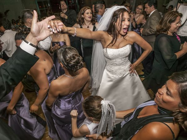 High angle view of bride and groom dancing at wedding reception