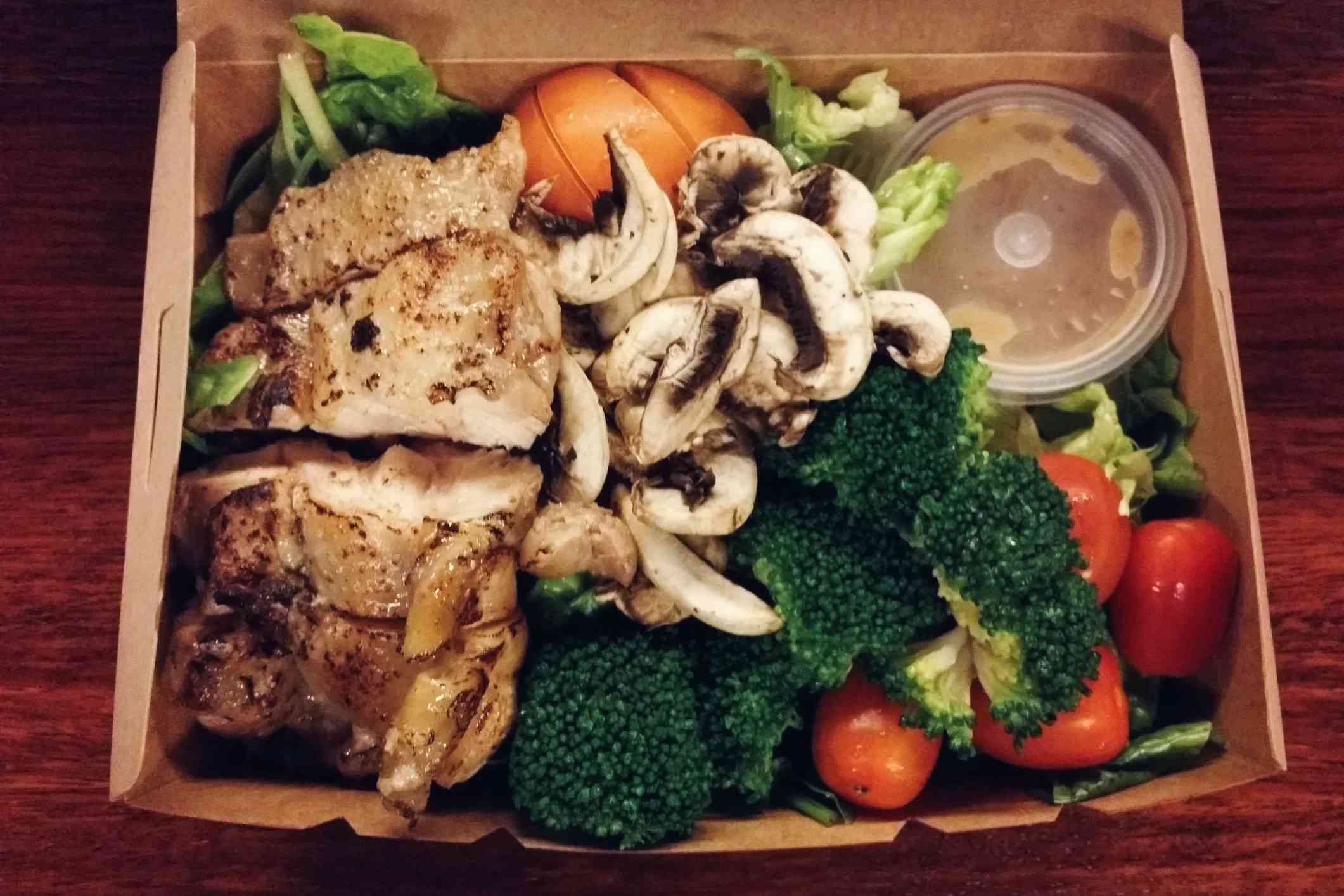 Meal kit with fish, vegetables, mushrooms, and dressing