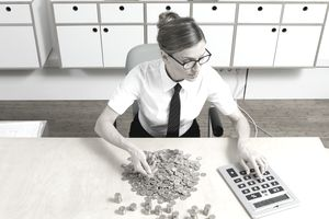 a young business woman counting coins