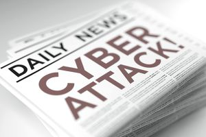 Cyber attack headline on a newspaper.