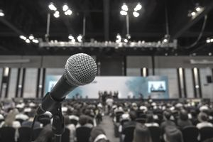 business and education concept, Microphone with Abstract blurred photo of conference hall or meeting room with attendee background