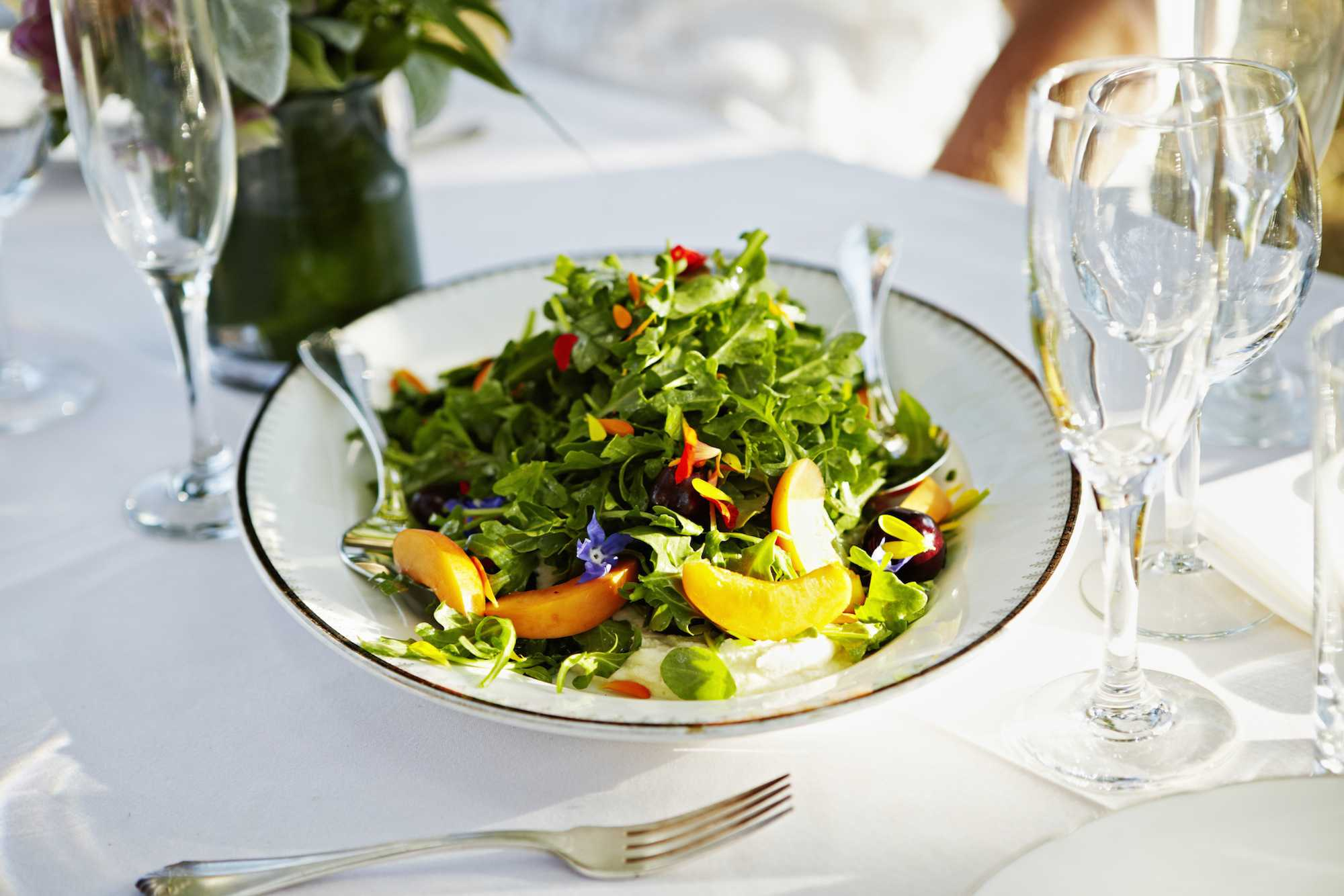 Plate of salad on outdoor banquet table