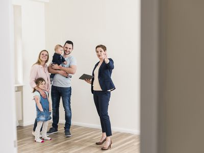 Picture of a family talking to a Property Manager