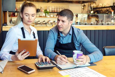 Small family restaurant owners discussing finance