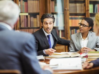 Lawyers meeting in a law library