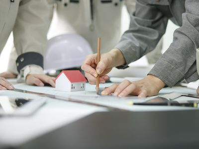 Close up of architects reviewing blueprints in office