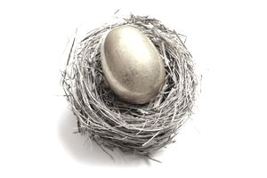 Retirement savings golden egg resting in a nest