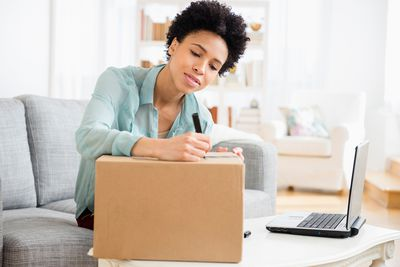 Woman addressing package