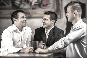 Businessmen in a bar for a client event.