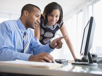 Man and woman consulting at a computer.