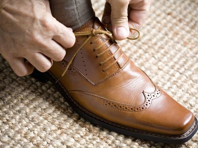 Close up of hands tying shoelace