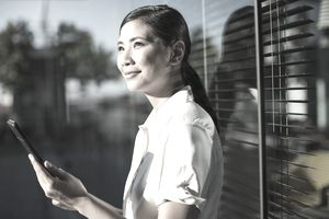 Smiling businesswoman using digital tablet outdoors