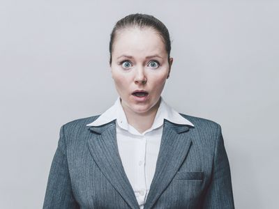 Woman in business suit looking surprised