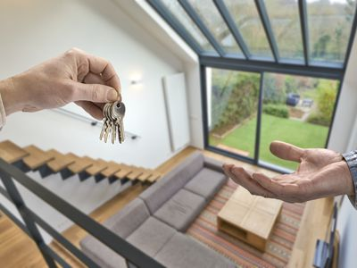 Realtor giving house key to buyer