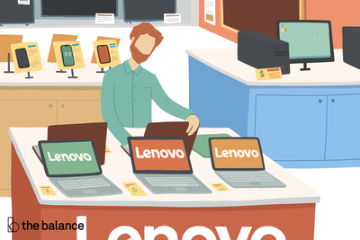 Image shows a man in a tech store looking at Lenovo laptops.