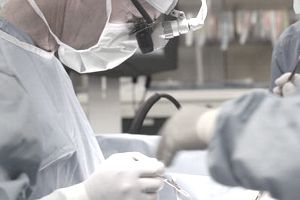 surgeon photo, surgeon image, surgeon at work image, surgeon in OR image, surgeon operating image